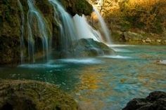 Turner Falls cascades 77 feet into a natural swimming pool in the Arbuckle Mountains. by mona