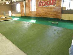 Edge Fitness new Hamden CT club during. Brite, open, nice contrast between running lane and functional area.