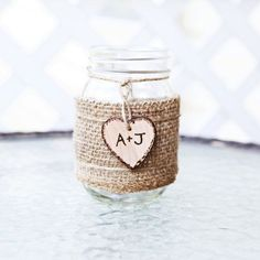 Personalized Rustic Mason Jar Vase with brown burlap wrap and custom wood heart. Also great for Christmas or holiday gift gifts, baby shower prize prizes, bridal shower favors, wedding party, flower bouquet holder, diy centerpiece, favor, table number sign, and more! by natasha
