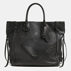 -sob- fantastic but huge, which means expensive lol. TATUM LARGE STUDDED TALL TOTE IN WHIPLASH LEATHER