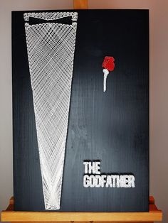 """The Godfather String Art. """"I'm Gonna Make Him An Offer He Can't Refuse."""" Who doesn't love a good movie? But if you are a movie buff this minimalist StringArt poster will get your movie senses tingling in an instant. Show everyone who is Il Padrino, The Don with this Godfather themed String Art poster."""