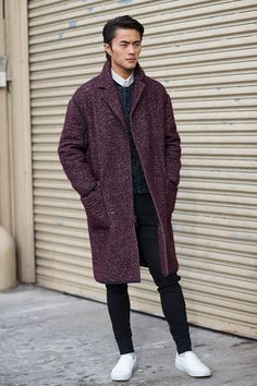 Great colour, texture and detail. I love the black piping and the dropped shoulder of the coat and the crisp collar peering out from wintery layers.