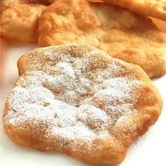 Pinner says: County Fair Fried Dough - Mmmm.I used to make fried dough with store bought bread dough all the time as a kid. Growing up hasn't stopped me from eating fried dough, but now I can make the dough from scratch! Just Desserts, Delicious Desserts, Dessert Recipes, Recipes Dinner, Deep Fried Desserts, Fried Dough Recipes, Gluten Free Fried Dough Recipe, Fried Dough Recipe Without Yeast, Biscuit Dough Recipes