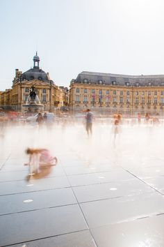 """This is the Place de la Bourse and its """"miroir d'eau"""", it cools off in summer with the heat 😁 Visit the region with us, we organize your trip for you, and spend the night in one of our chateaux for this occasion ! #bordeaux #summer #placedelabourse #miroireau #holiday #summerholiday #seminar #corporate Location, Where To Go, Travel Guide, Organize, Night, Places, Holiday, Summer, Lush"""