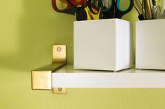 Use Montana gold spray paint to transform Ikea Ekby Bjarnum silver shelf brackets  into beautiful gold ones!