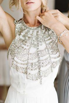 This backless, beaded wrap-around: | 32 Strikingly Beautiful Wedding Dress Details