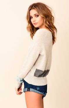 360Sweater Drei Sweater  The Drei Cashmere Sweater by 360sweater features a relaxed fit, scoop neck, ribbed trim, long sleeves, and charcoal and light blue stripe detailing at the bottom.