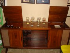 A 1960's console stereo re-purposed into a bar. Visit me on facebook. Designs by Spofford Studio.