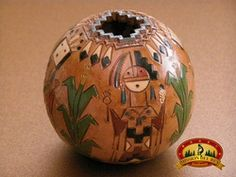 This is a high quality piece of authentic Native American, Navajo pottery. This unique piece of Navajo pottery is artfully hand tooled to decorate the rustic vase. The artist cuts the design by hand b