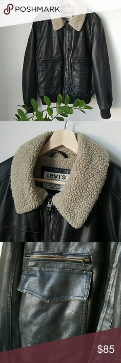 Levis Faux Leather Sherpa Flight Bomber Awesome faux leather sherpa lined bomber from Levi's in a black / chocolate brown color. Has a flight / utility feel with its distressed look around pockets and zippers. Features two large front pockets as well as an interior pocket. Very very warm. Size L.  Has light piling on bottom fabric but in otherwise like new condition. Levis Jackets & Coats Bomber & Varsity