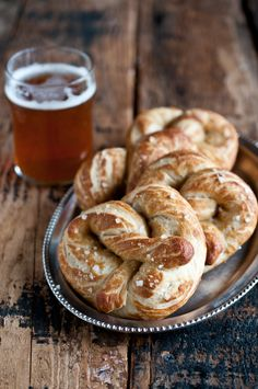 """Super Soft Beer-Infused Garlic Butter Pretzels ..... There are some really intriguing reasons to cook with beer, not the least of which is figuring out what to do with the """"leftover"""" beer once the recipe is made. One of my favorite practical reasons is that beer is …"""