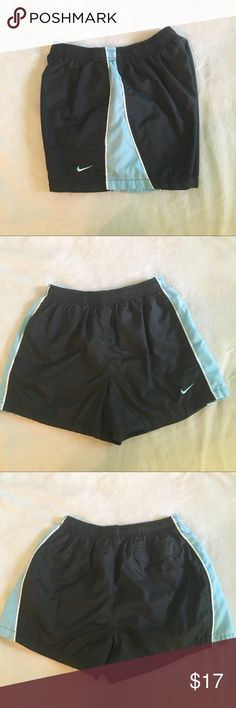 Blue and black Nike shorts Blue and black Nike shorts with pockets on the front and one on the back. In great condition😊 Nike Shorts