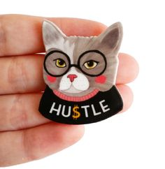 This quirky Hustle Cat pin. | Community Post: 15 Empowering Gifts For The Most Badass Babe In Your Life