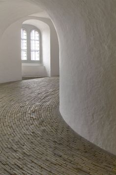 Rundetårn © Hannu Lilja - Handmade tiles can be colour coordinated and customized re. shape, texture, pattern, etc. by ceramic design studios Casa Park, Eco Construction, Architecture Design, Architecture Memes, Architecture Interiors, Keramik Design, Round Tower, Curved Walls, Handmade Tiles