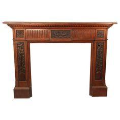 For Sale on - Late century Louis XVI style carved wood fireplace surround The large and hand-carved frieze centered with a plaque depicting the mythological bird Wood Fireplace Surrounds, Fireplace Mantels, Antique Furniture, Modern Furniture, Traditional Fireplace, Louis Xvi, Carved Wood, Hand Carved, Entryway Tables