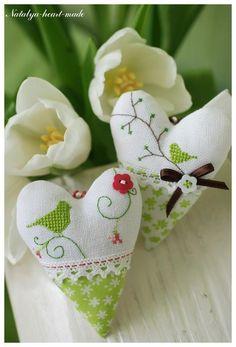 So pretty! Fresh little birdies on fabric hearts...