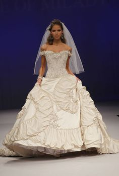 Brides: Eve of Milady - Fall 2012. Off-the-shoulder satin ball gown wedding dress with a beaded lace bodice and sweetheart neckline, Eve of Milady