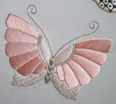 Design, © Jennifer Ashley Taylor This butterfly represents my Mum. It is stitched in two shades of pink silk and silver metallic threads