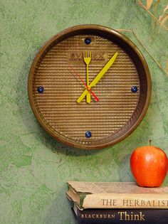 This I like!  And, because I aim to have a wall clock in every room it's a perfect choice (and diy project) for my kitchen.  Check out the other ideas at this link.  Some are pretty unique!.  --  30 Adorable Repurposed Kitchen Items
