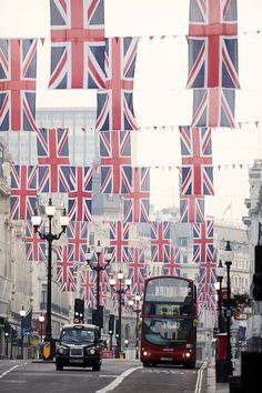 In preparation for the Queen's Diamond Julibee Union Jack pageantry hangs over Regents Street at sunrise on May 25, 2012 in London, England.