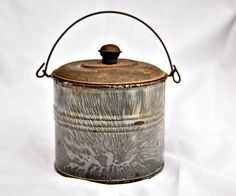 Retro lunch bucket. Vintage. Lidded can. Little house on the Prairie. Tin.