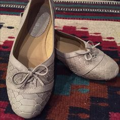 Cute Gray Snakeskin look flats Latigo, leather, size 8 flats. These have been worn (price reflects that). Cute to wear with skinny jeans or boyfriend jeans. Too small for my foot. They also have a leather sole. Latigo Shoes Flats & Loafers