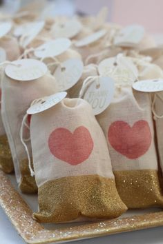 Cute little burlap favor bags with glittery gold and red heart design