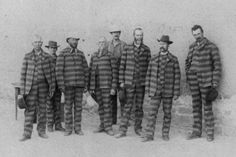 ca. 1885, Utah state prisoners  The distinctive, horizontally striped uniforms were commonly worn by 19th century convicts to render them recognizable in case of an escape.
