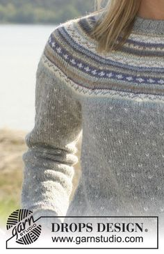 "DROPS jumper in ""Alpaca"" with round yoke and multi coloured pattern. Long or short sleeves. Size XS - XXL."