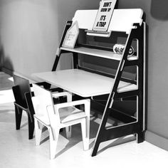 Desk Evo by Slide Art can be put together without a screw or glue. You slide the parts together. The desktop can be placed on two different heights. Here on kids level. The two kids chairs can be personalized by branding your kids name in the chair  Order now.