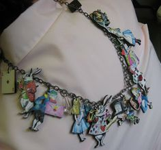 Alice in Wonderland Charm necklace.  I so covet this!