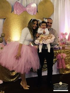 Fatima's First Birthday Party, featuring a custom gold glitter 8' Mouse backdrop