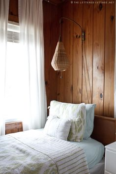 LOVE the vintage sconce.will a pull cord no less. Knotty Pine Decor, Knotty Pine Walls, Wood Panel Walls, Wood Paneling, Wall Wood, Pine Beds, Hygge Home, Bedroom Wall, Pine Bedroom