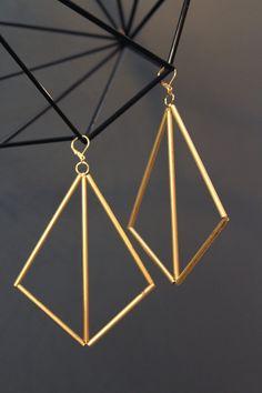 """I own a pair of Megin Sherry's giant geometric earrings and I get compliments on them wherever I go."" - Jaime Derringer #DesignMilk"