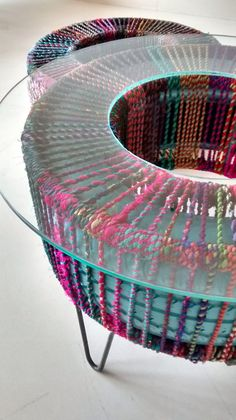 Tyre planter tables..with  colourful recycled textile rope