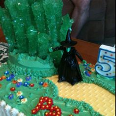 """Homemade """"Wizard of Oz"""" cake close-up: Emerald City made from rock candy, though I would use old fashioned candy sticks next time. Name spelled out in """"poppies"""" using star tip + candy center."""