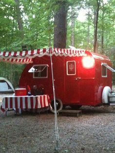 little red trailer...love the striped awning and matching tablecloth.