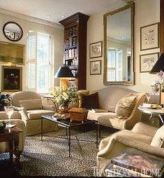 This living room with a color scheme of earthy greens, khaki, cream, and brown is punctuated with a leopard rug. - Traditional Home ® / Photo: Jenifer Jordan / Design: David Smith - Modern Living Room Beautiful Living Rooms, Cozy Living Rooms, Home Living Room, Living Room Designs, Southern Living Rooms, Sitting Rooms, Living Room Decor Traditional, Traditional Interior, Traditional House