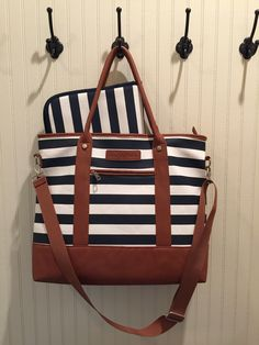 Large diaper bag in navy stripe. Multiple internal pockets and comfortable handles. Practical and affordable!