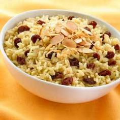 Ginger, Coconut & Currant Rice Recipe Side Dishes with vegetable oil, onion, garlic, fresh ginger, regular or convert rice, flaked coconut, Knorr Chicken Flavor Bouillon, water, raisins
