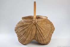 "Contemporary concept on a traditional style ribbed egg style basket, this basket is woven on a 20"" round hoop (handle) and a 12x20"" wide oval oak hoop. weavers are 11/64ths inch wide."