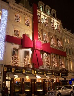"""Cartier at Christmas in NYC. Funny how I can't afford to shop in most 5th Avenue stores, but they are part of New York and therefore they are part of me. """"My"""" New York Cartier. :)"""