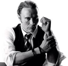 Dr Lecter rolling up his sleeves.. To cook?