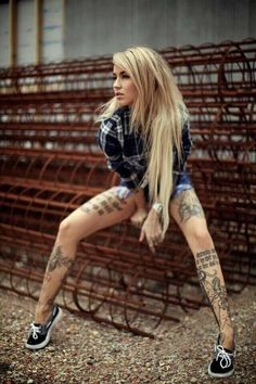 I have never liked leg tattoos before this picture. She did it right.