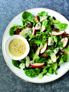 Ingredients80g bag watercress 150g young spinach leaves 2 South African Pink Lady apples, cored and sliced 2 tbsp lemon juice 2 sticks celery, thinly sliced 50g raisins or sultanas 150g Stilton cheese, broken into chunks 80g pecan nuts 10g butter 1 tsp caster sugar Pinch of sea salt fl