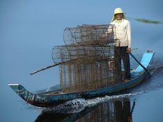 A balancing act on Tonle Sap Lake, Cambodia  Photo: Chris Davies of Llandysul, Carmarthenshire