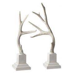 """Add a rustic touch to your shelves or mantel with this eye-catching bookend, showcasing an antler silhouette.  Product: Small and large bookendConstruction Material: ResinColor: White Dimensions: Small: 25"""" H x 7"""" W x 7"""" DLarge: 28"""" H x 10"""" W x 7"""" DCleaning and Care: Wipe with damp cloth"""