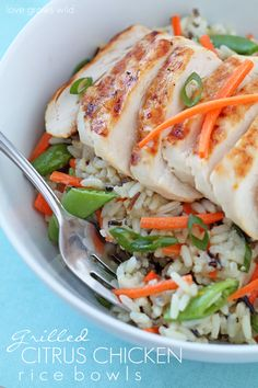 Grilled Citrus Chicken Rice Bowl - Tender grilled chicken, fresh, crisp vegetables, and a tangy citrus dressing come together in a delicious rice bowl!