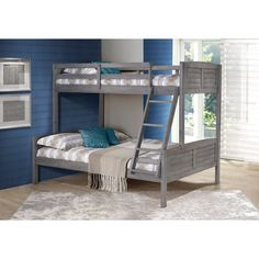 Make a style statement with the Donco Kids Louver Bunk Bed with built-in ladder. The rustic antique gray finish lends a stylish look to your decor. The bunk bed has a solid wood construction, which ma
