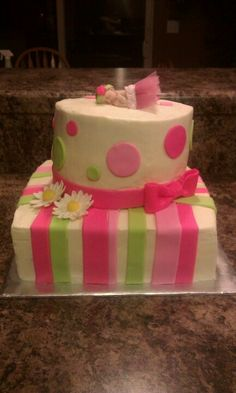 Baby girl shower cake with fondant stripes & daisies. Baby made out of gumpaste